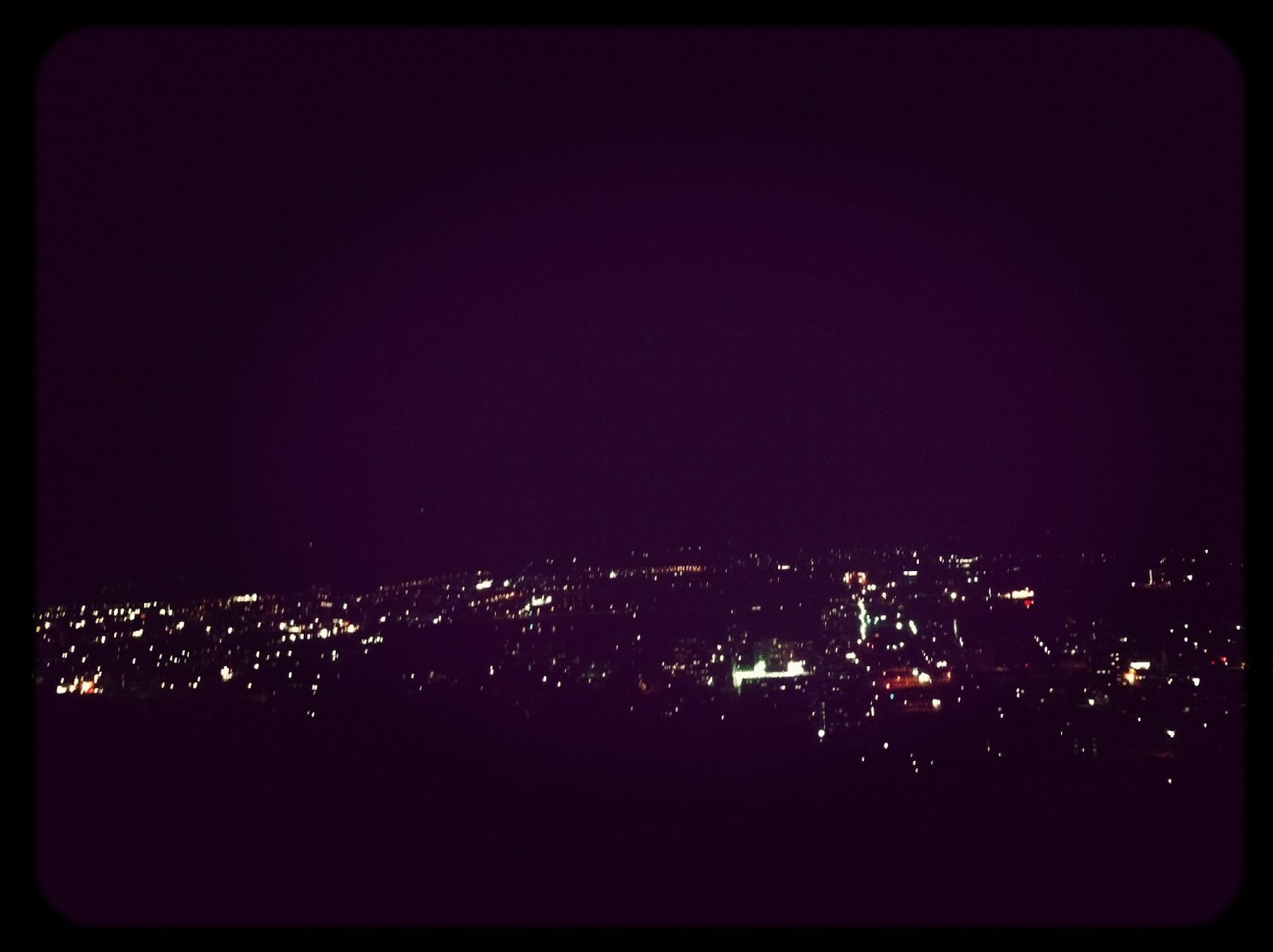 night, illuminated, cityscape, city, building exterior, architecture, copy space, built structure, crowded, clear sky, dark, high angle view, residential district, residential building, sky, city life, no people, skyscraper, light, residential structure