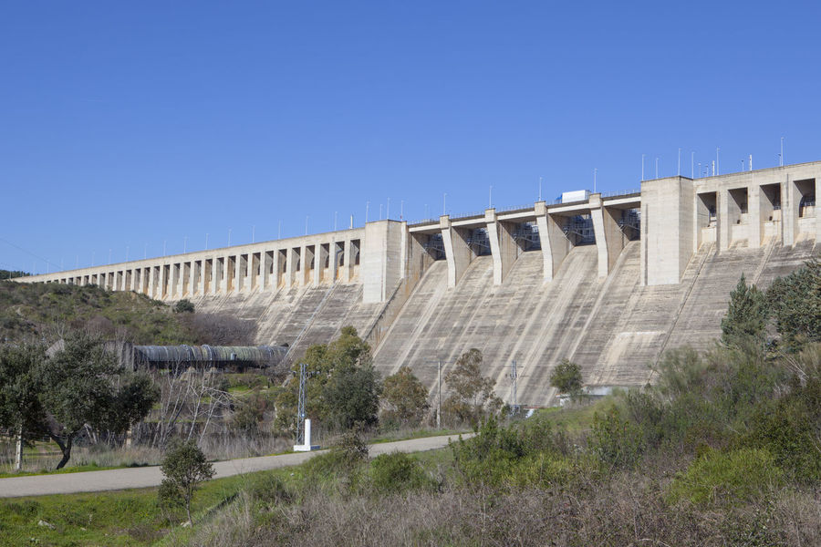 Gabriel y Galan reservoir, Caceres, Spain. Hydro-electric plant area Arch Architecture Built Structure Clear Sky Dam Day Hydroelectric Power Irrigation Equipment Modern Nature No People Outdoors Tree
