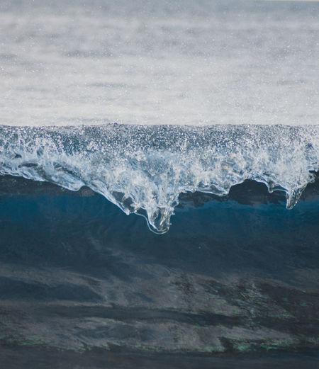 Aerial view of sea waves splashing on shore