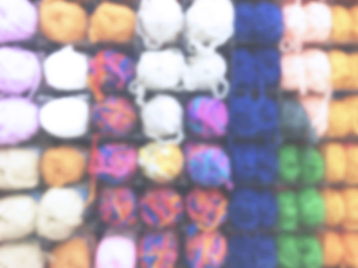 colorful yarn showing on shelf Multi Colored Full Frame Large Group Of Objects Backgrounds Choice Variation No People Abundance Indoors  Pattern Close-up In A Row Creativity Still Life Retail  For Sale Store Arrangement Design Shape Consumerism Yard Shelf