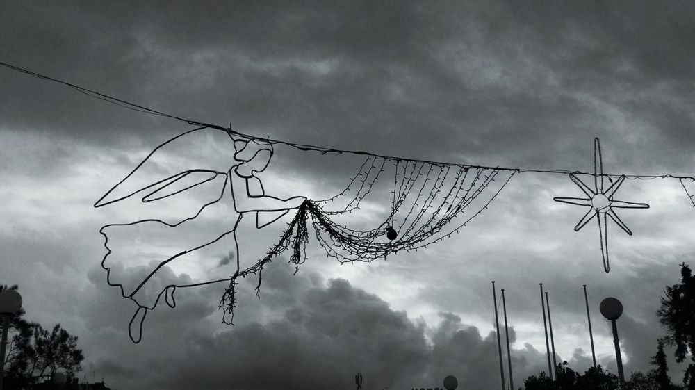 Angels above... Christmas Spirit Christmas Angel Cityscape Dramatic Sky Low Angle View Xmas Xmas Decorations Xmas Lights  Angel Black And White Black And White Friday Cloud - Sky Clouds Day High Above Low Angle View Monochrome Photography No People Ominus Outdoors Prespective Sky Star Shape Urban Decay Urban Skyline