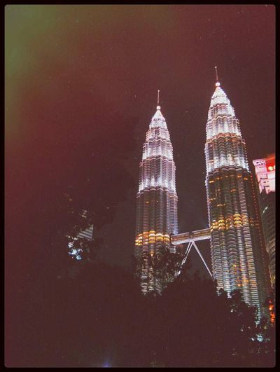 the Twin Towers at night-time. Artsy Fartsy Malaysia GetYourGuide Cityscapes