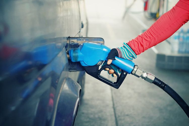 Hand holding nozzle fuel for fill oil into car tank at gas station Gas Transport Transportation Energy Benzine Power Technology Expensive Fuel Petrol Investment Petroleum Oil Gasoline Cost Vehicle Industry Hose Pump Business Save Development Safety Gasoline Environment