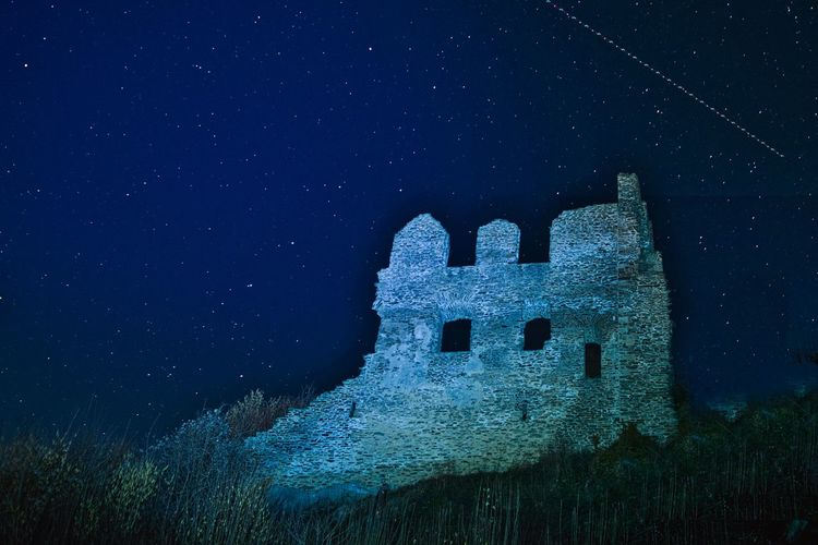 Old ruin of star field at night