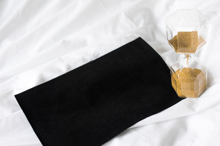 High angle view of coffee cup on bed