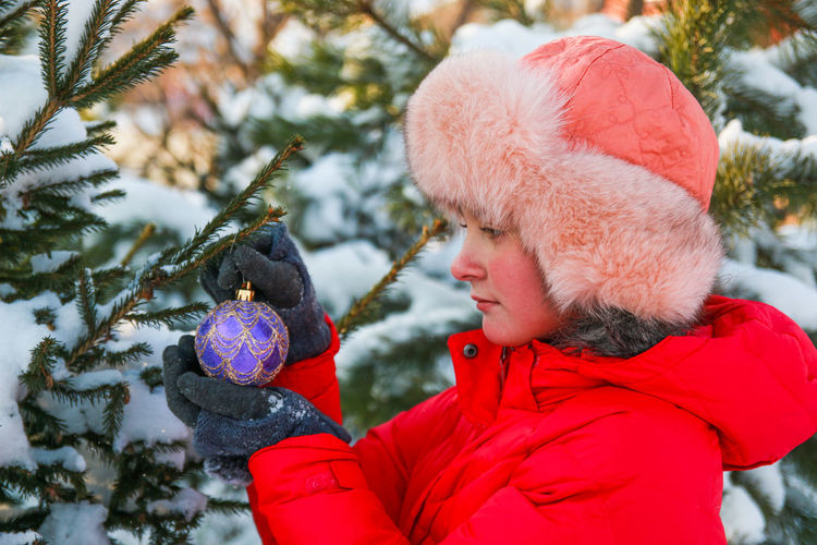 Close-up of woman holding christmas ornament
