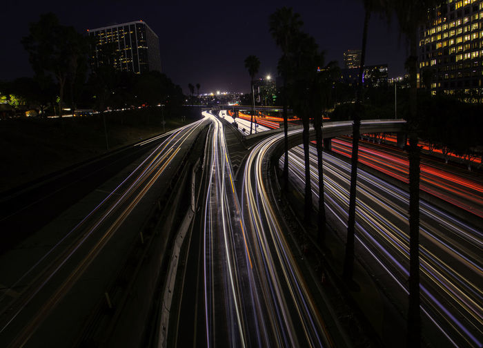 High angel view of light trails on road at night
