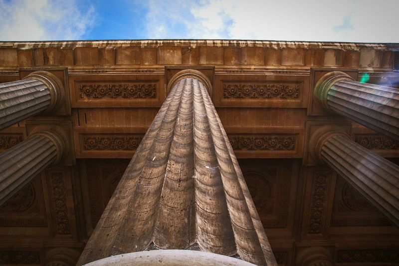 Dramatic Angles Architecture Low Angle View Built Structure Building Exterior History Sky Building Architectural Column Architectural Feature Outdoors OrnateArch The Past Famous Place Cloud Church Cloud - Sky Façade The Graphic City
