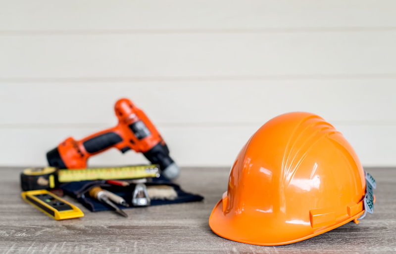Close-up of construction equipment on table