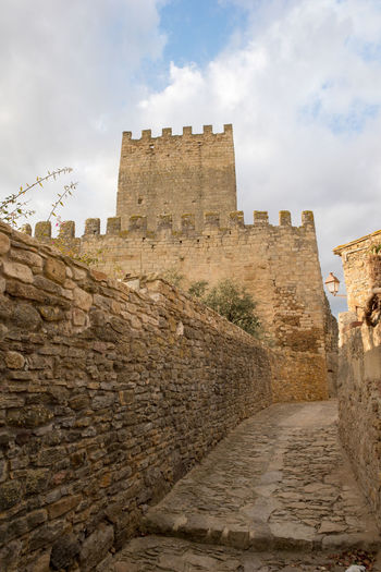 Catalonia Country Girona Rural SPAIN Ancient Ancient Civilization Architecture Building Exterior Built Structure Castle Cloud - Sky Day Fort History Low Angle View Medieval No People Old Old Ruin Outdoors Peratallada Sky Tourism Travel Travel Destinations