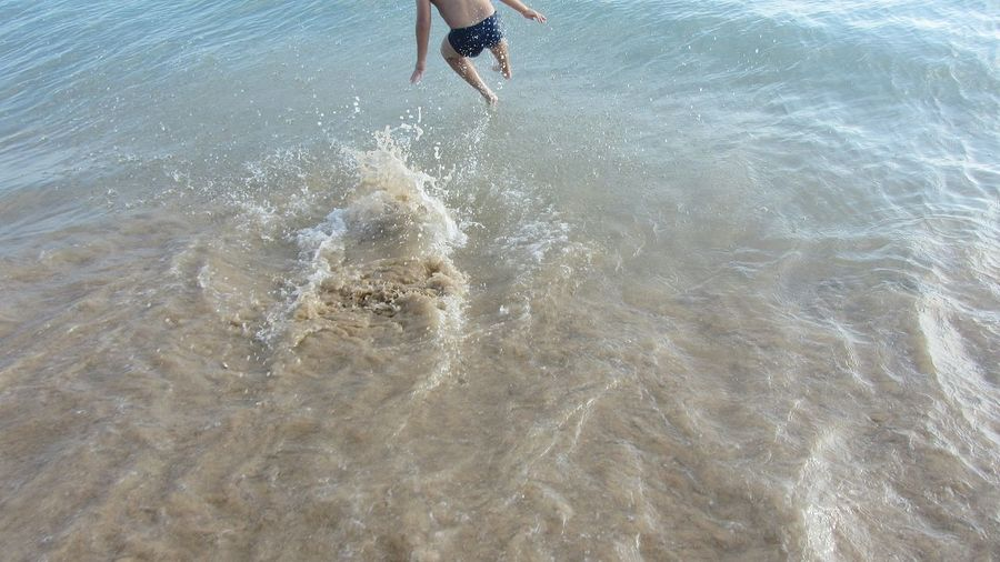 My son jumping to.... Taking Pictures Beach Time Jumping For Joy Jumping Shot Being A Beach Bum I Love My Son Lets Go Swimming Beach Life Beach Day Taking Photos