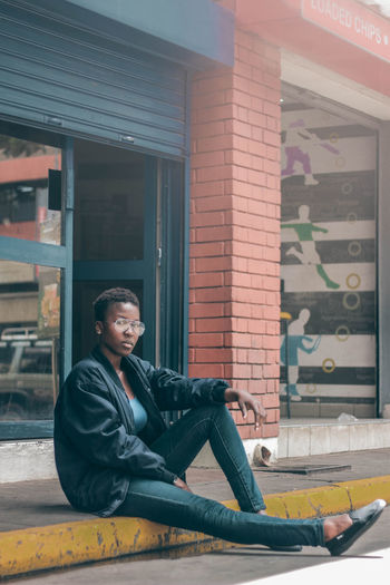 Portrait EyeEm EyeEm Best Shots Fresh On Market 2018 Streetphotography Teenager Young Adult Africa Woman One Person Adult Sitting Full Length Outdoors Portrait City