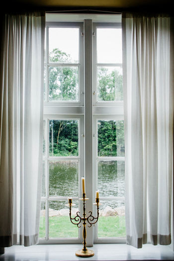 Candles with holder at window