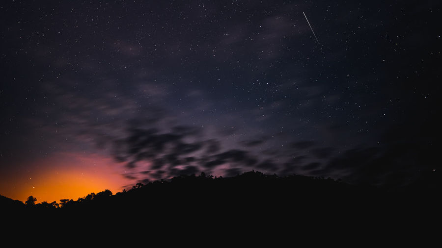 Meteor and star in the night before sunrise