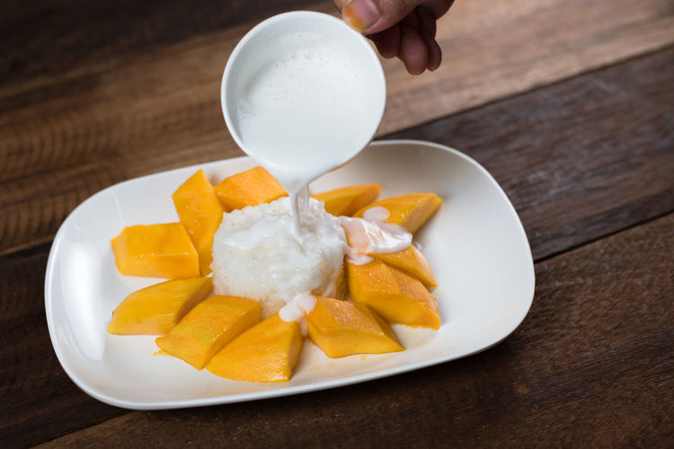 Mango sticky rice or khaoniao mamuang, a traditional thai cuisine
