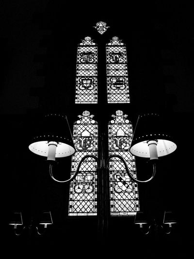 Books and Stones 6: Lunch with God. Monochrome monochrome photography Monochrome _ Collection Books And Stones Be Quiet Old Blackandwhite Bnw_collection University Table Lamp Symmetry Perspective Cathedral Dark Dining Table Dining Room Window Symmetry Black White Hallway Chair
