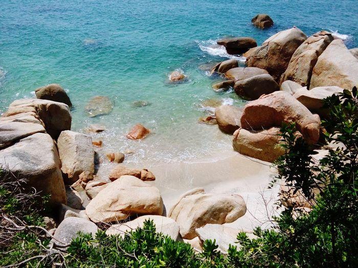 Scenic view of teluk cempedak with rocky shore