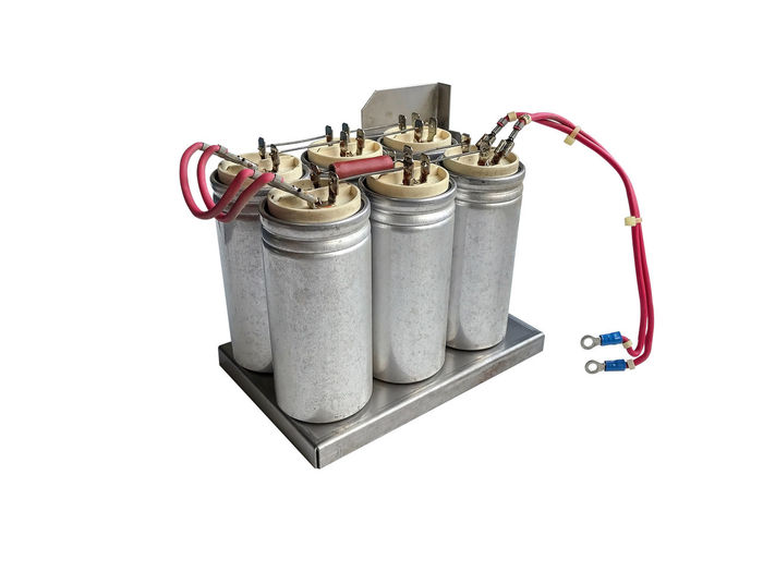 Group of capacitors isolated on white background. White Background Studio Shot Metal Still Life Cut Out No People Indoors  Equipment Technology Copy Space Connection Close-up Fuel And Power Generation High Angle View Cable Red Electrical Equipment Man Made Convenience Container Power Supply Electrical Component Isolated Capacitor Electricity