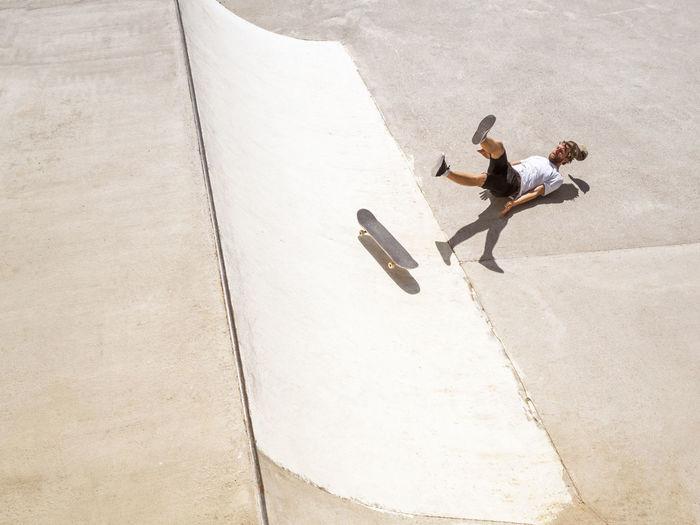 High angle view of woman walking on skateboard