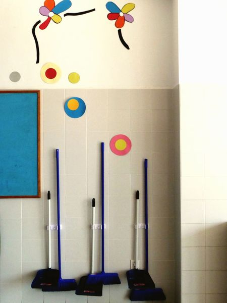 Orderly Arranged No People Hanging Indoors  Multi Colored Day Brooms  Storing Space Dustpan No People Hanging Childhood Indoors  Multi Colored Clock Day Clock Face Beautifuly Organised