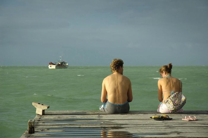 Beauty In Nature Day Holbox Holbox Island Leisure Activity Mexican Beaches Outdoors Real People Rear View Sea Shirtless Sitting Sky Summer Sunlight Togetherness Two People Vacations Water Wood - Material Young Adult The Great Outdoors - 2017 EyeEm Awards