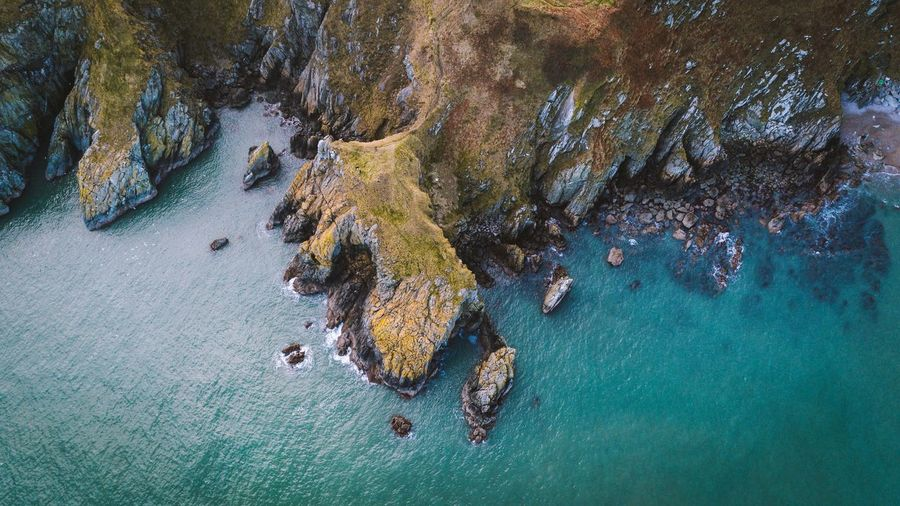 Irish coastline. Rock - Object Rock Formation Sea Nature Water Scenics Beauty In Nature Beach High Angle View Landscape Tranquility No People Cliff Outdoors Blue Travel Destinations Cave Day Eyesight UnderSea Ireland