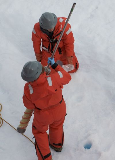 High angle view of workers standing on ice