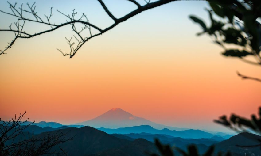 Distant View Of Mt Fuji Against Sky During Sunset