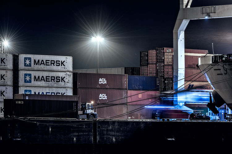 loading Container Container Ship Container Bridge Move Blured Motion Long Exposure Artificial Light Spotted Lantern Pier Blue Light Truck Architecture Illuminated Built Structure City Night Transportation No People Mode Of Transportation Industry Sky Street Lens Flare Road Lighting Equipment Text Outdoors Motion