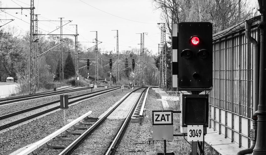 Black & White Black And White Colorkey Day EyeEm Best Edits Keycolor No People One Color Outdoors Rail Transportation Railroad Track Railway Signal Red Red Light Road Sign Schienen Signal Sky Stop Stoplight Transportation Transportation Tree Urban Krull&Krull Images Colorkey