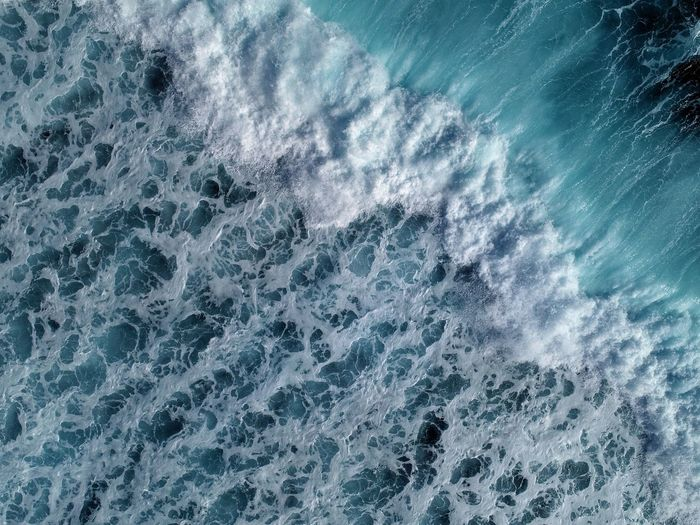 Directly above shot of waves in sea
