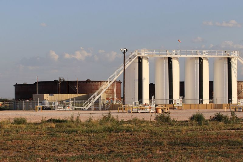 Crude oil storage Midstream Permian Basin Oil And Gas Industry Pipeline Texas Energy Crude Oil Petroleum Sky Architecture Built Structure Building Exterior Nature Industry Day Outdoors Cloud - Sky Storage Tank No People Crane - Construction Machinery