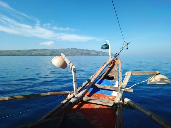 Fishing Boat In Sea Against Blue Sky