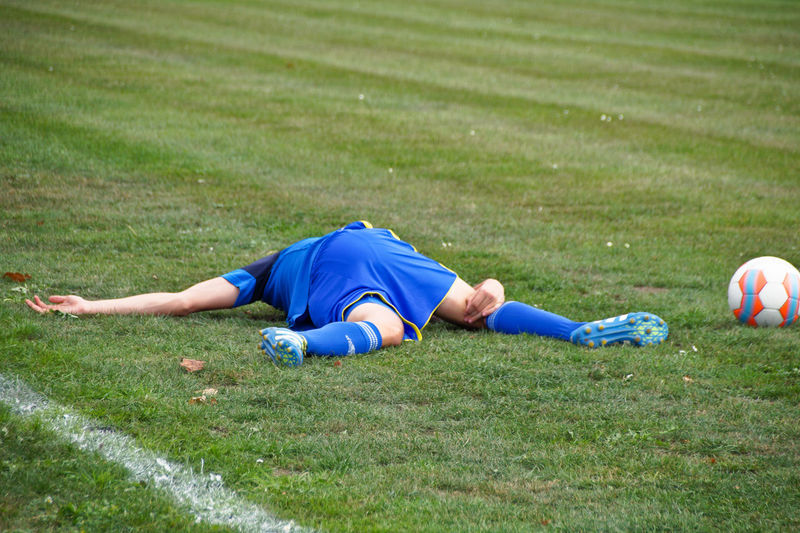 Injured Player Lying On Field