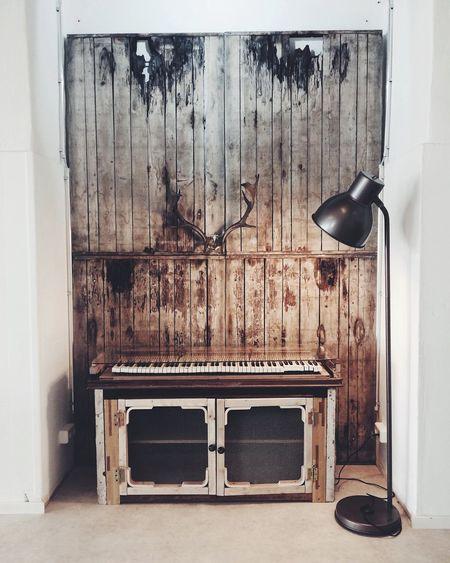 Floor lamp against wooden wall