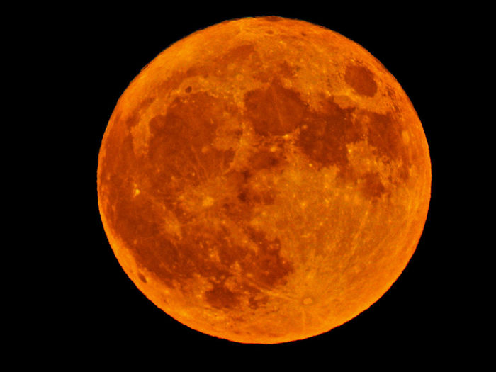 Astronomy Beauty In Nature Black Background Circle Eclipse Full Moon Geometric Shape Majestic Moon Moon Surface Natural Phenomenon Nature Night No People Orange Color Outdoors Planetary Moon Scenics - Nature Shape Sky Space Yellow