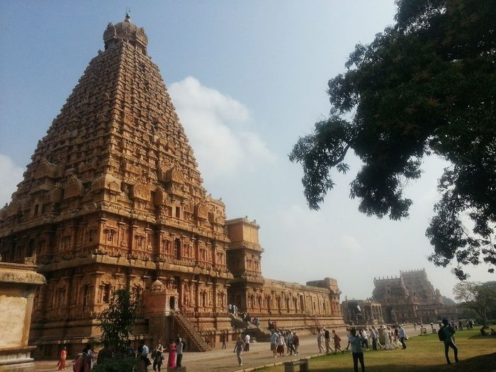 Built Structure Architecture Building Exterior Travel Destinations Plant Tree Sky History Nature The Past City Tourism Travel Building Religion Outdoors Place Of Worship Low Angle View Incidental People Big Temple Full Length at Tanjore