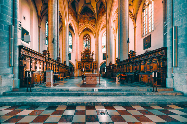 "Ingolstadt, GERMANY - January 31, 2019: The interior of the famous church ""Muenster zur schönen lieben Frau"" impresses with rich christian ornaments and paintings Architecture Built Structure Building Building Exterior Flooring Arch Tile Belief Religion Place Of Worship Window Tiled Floor No People Illuminated Spirituality Day Architectural Column"
