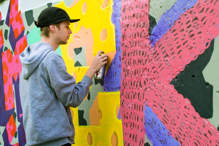 Casual Clothing Colorful Graffiti Graffiti Art Graffiti Wall Guy Hands At Work Man Made Object Modern Modern Art Multi Colored Mural Mural Art Outdoor Photography Outdoors Painting People And Places Street Street Photography Yellow Young Youth Of Today