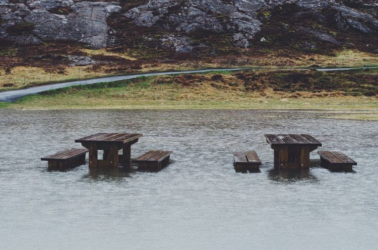 Stop-over Lake Rain Summer Travel Beauty In Nature Road Trip Iceland Day Nature No People Land Plant Tranquility Field Table Outdoors Tree Tranquil Scene Beauty In Nature Growth Built Structure Sunlight Seat Architecture Water Wood - Material Scenics - Nature The Traveler - 2018 EyeEm Awards