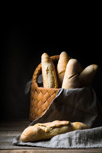Still Life Bread Black Background Indoors  Food Freshness Food And Drink Loaf Of Bread Studio Shot No People Close-up Copy Space Basket Baked Table Brown Container Ready-to-eat Baguette Wood - Material French Food Snack Rustic Style The Foodie - 2019 EyeEm Awards