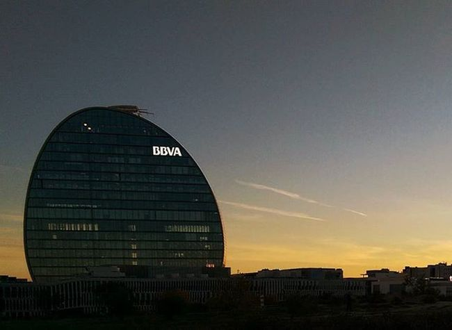 The new BBVA building in Madrid , SPAIN . It is apparently one of the most modern buildings but it seems narrow and transparent form outside. You can see the Sunset through its Windows . Htcm8 Htcphotography Mobilephotography Nofilter Snapsheed
