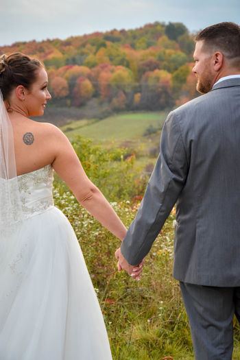 Happy couple standing on land