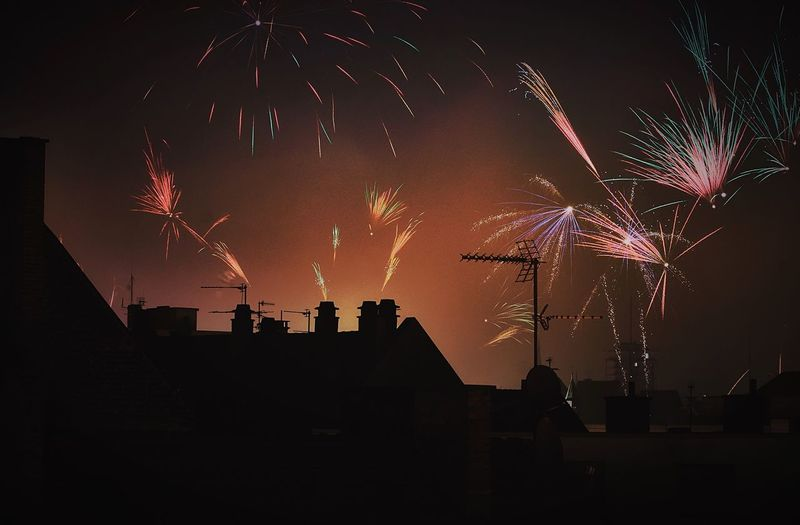Low Angle View Of Silhouette Building Against Firework Display
