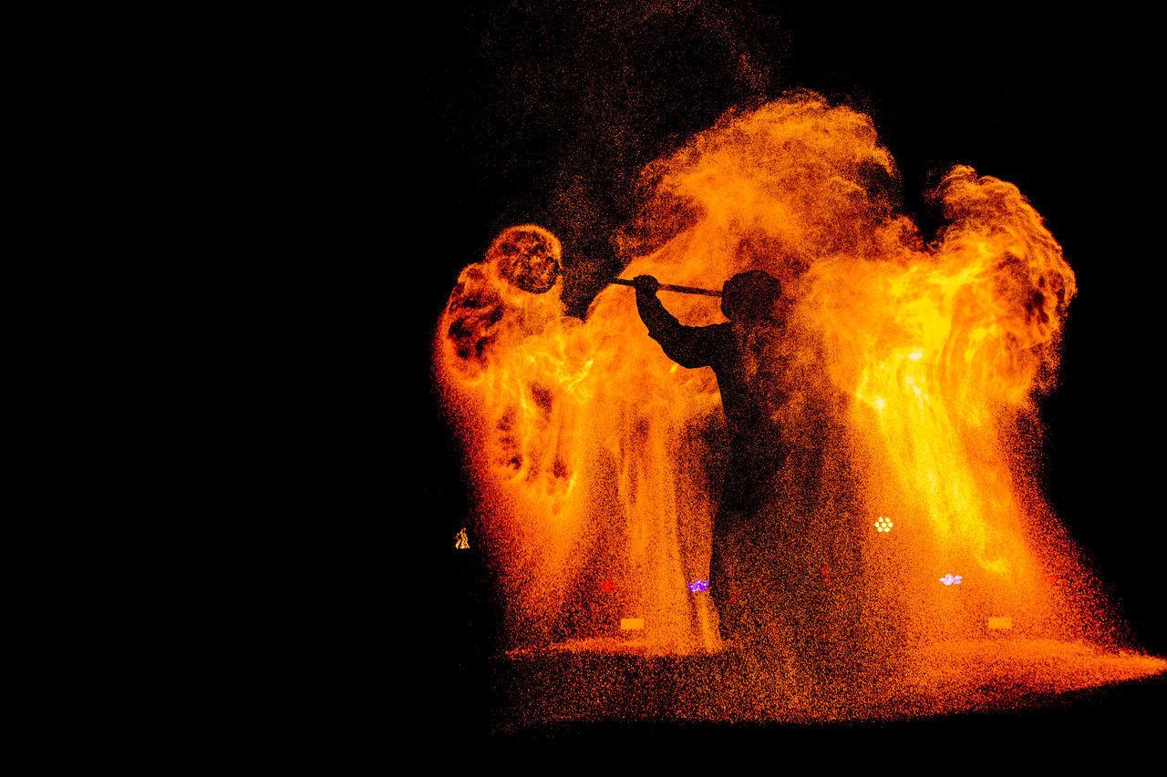 FIRE CRACKERS AGAINST DARK BACKGROUND
