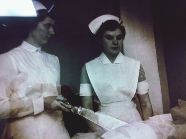 This is a pic of a pic in a hospital in Amaterdam, NY. Quite spooky! Does anyone know what these nurses are doing with a flashlight pointed at the patient? I would love to knOW on this Spooky Fall Evening Boo!