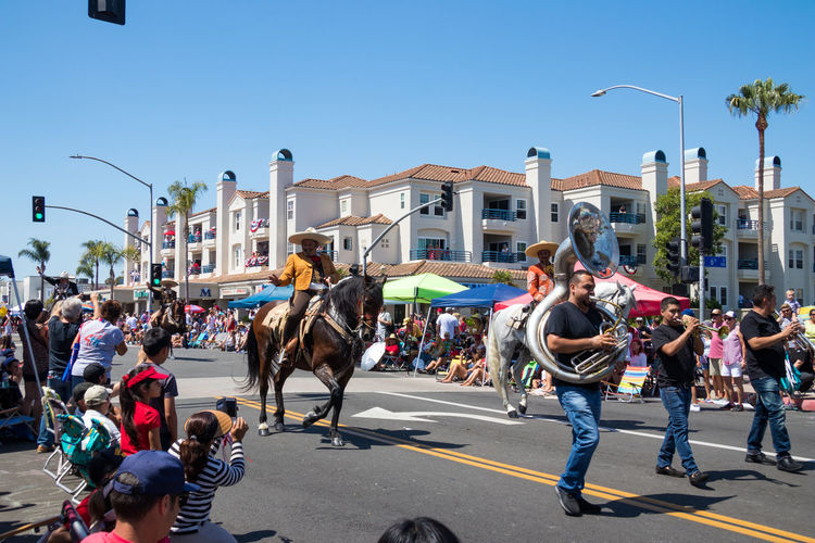 Spanish horses and riders in the Huntington Beach 4th of July parade 4th Of July American Beautiful Holiday Horses Huntington Beach Parade Main Street USA Patriotism Animals Caballeros Dancing Horses Editorial Use Only Equestrian Equine Independence Day Mexican Parade Spanish Horses Summer Sunny Day