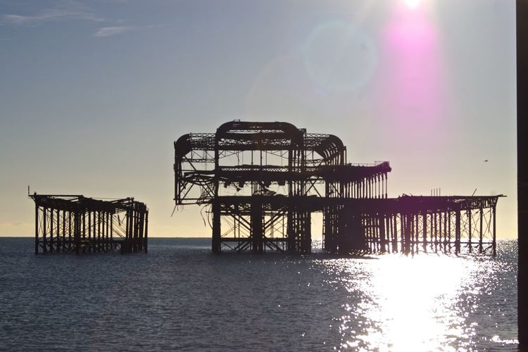 Abandoned Palace Pier In Sea Against Sky