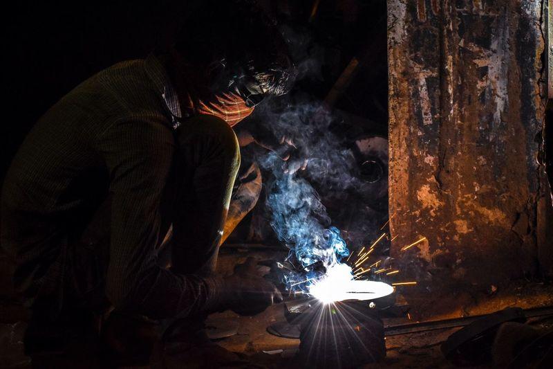 Man welding in factory