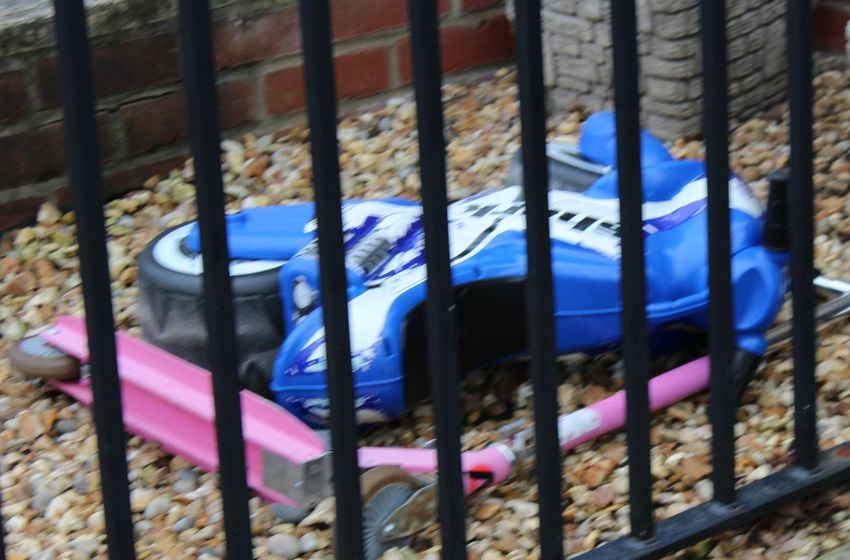 Abandoned Toys. Black. Blue Blue. Childrens Toys. Close-up Day Multi Colored No People Outdoors Pink Colour. Railings. Scooter Toy. Toys...